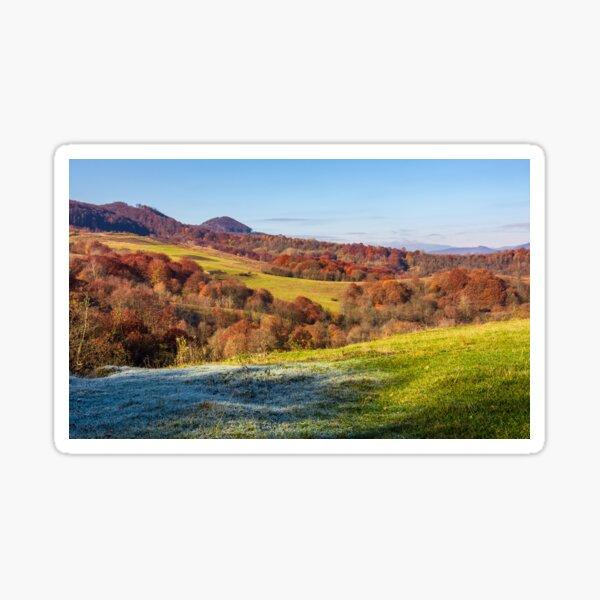 grassy meadow in mountainous countryside Sticker
