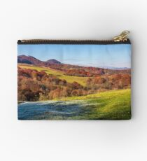 grassy meadow in mountainous countryside Studio Pouch
