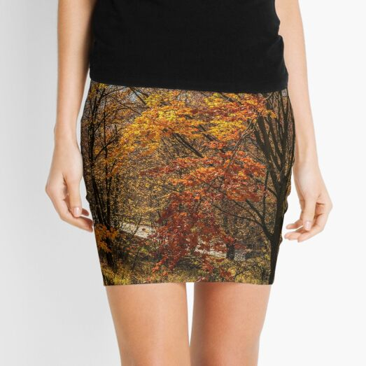 forest in golden brown foliage on sunny day Mini Skirt