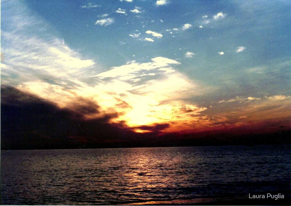 Sunset over Sanibel Island by Laura Puglia
