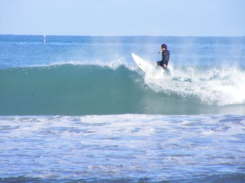 Surfer off the lip, Mullaloo by gamo