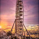 Ferris wheel at sunset by alan tunnicliffe