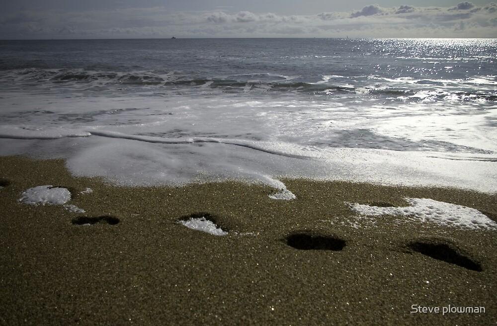 Footprints in the sand by Steve plowman