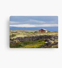 Small wooden cottage in Iceland landscape Canvas Print