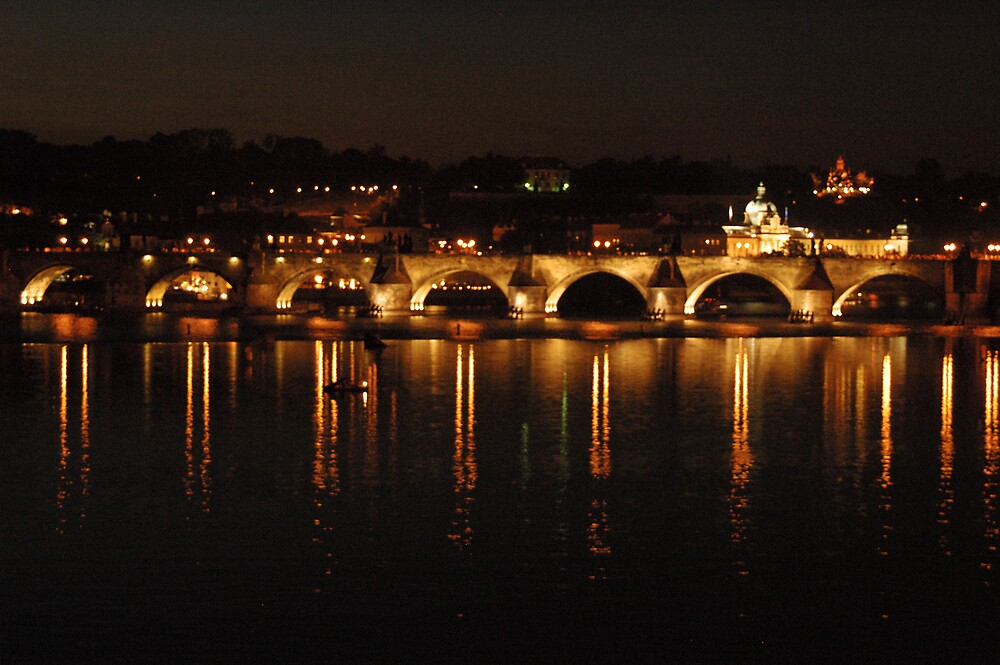 Prague at night across the water by Stan Daniels