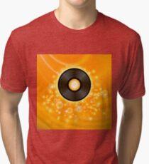 Retro Vinyl Disc on Orange Blurred Background Tri-blend T-Shirt