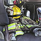 Yellow Fire Helmet In Fire Truck by Susan Savad