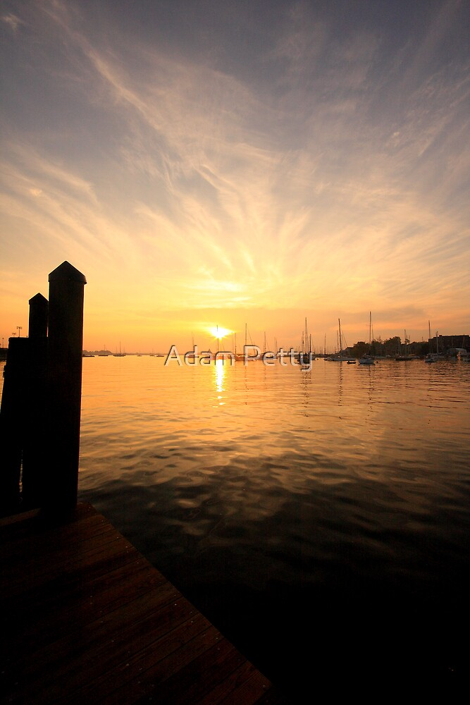 Amber Sunrise on the water by Adam Petty