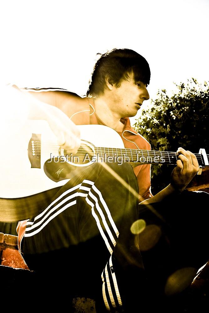 Playing Guitar by Justin Ashleigh Jones