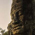A Giant stone face in bayon Temple - Cambodia by Christophe Dur