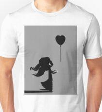 girl letting out a heart shaped ballon T-Shirt