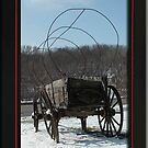 Vintage Covered Wagon in the Snow by toots