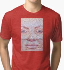 Pretty girl face against transparent water drips as background. Tri-blend T-Shirt