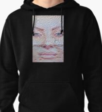 Pretty girl face against transparent water drips as background. Pullover Hoodie