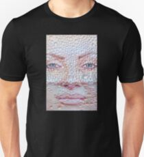 Pretty girl face against transparent water drips as background. Unisex T-Shirt