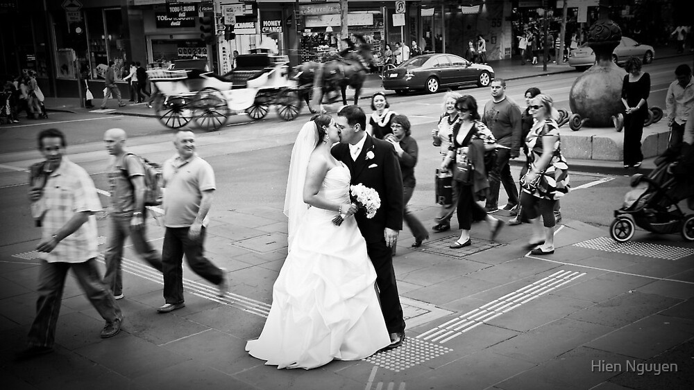 For a split second in time, Emily & Paul were oblivious to the world going by. by Hien Nguyen