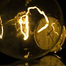 Incandescent light bulb with a Raketa watch close-up by wildrain