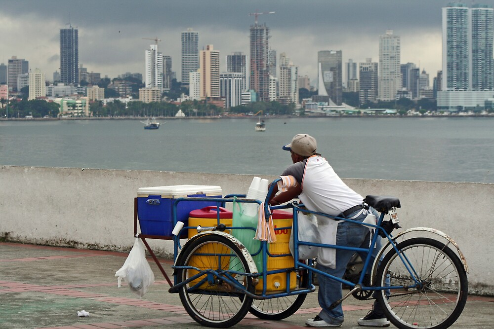vendor looking at Panama City skyline by Karen Millard