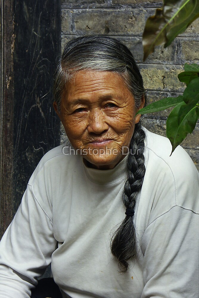 A nice old woman - China by Christophe Dur