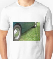 Vintage green classic car side view closeup on grass T-Shirt