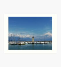A lighthouse on the harbour wall  Art Print