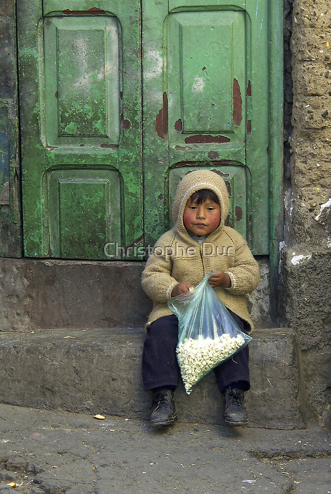 Small boy eating pop corn - Bolivia by Christophe Dur