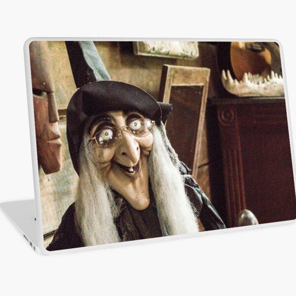 Vintage witch closeup log house Laptop Skin