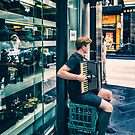 Boy playing a accordion by Adriano Carrideo