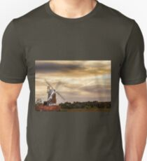 Cley windmill with flock of birds at sunset in Norfolk UK T-Shirt