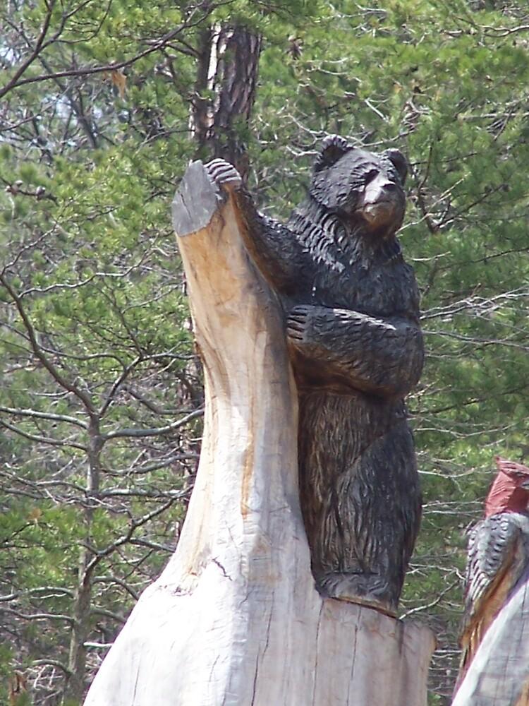Bear carved into tree by MeMeBev