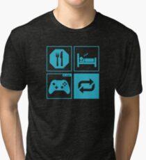 Eat, Sleep, Game, Repeat. Tri-blend T-Shirt