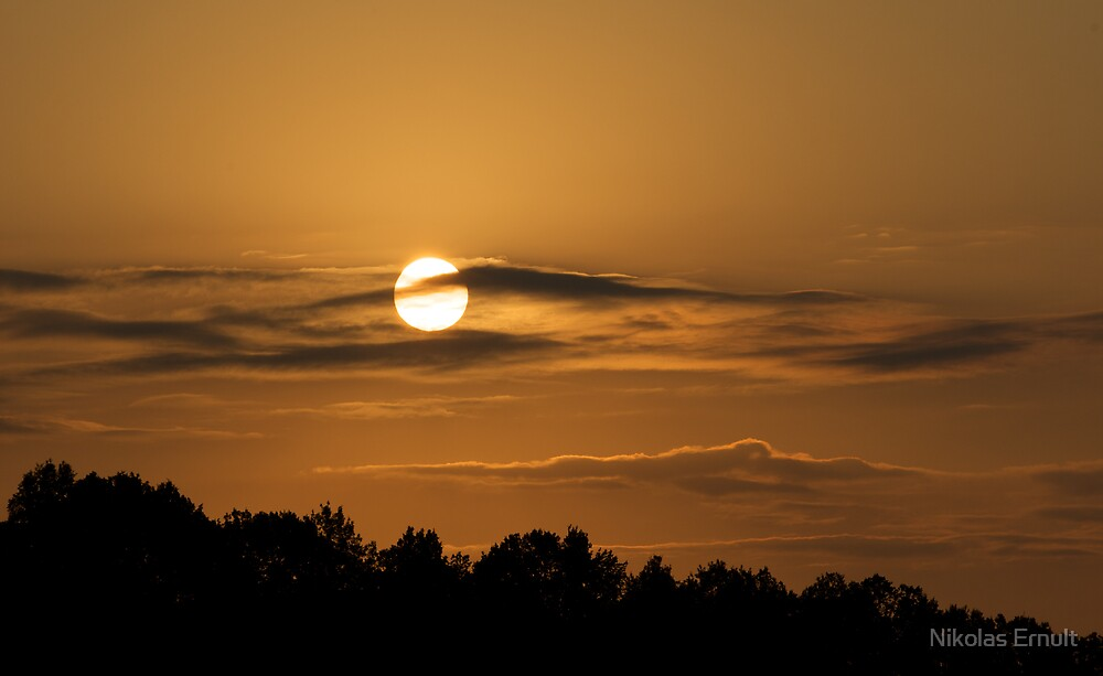 Clouds and sun by Nikolas Ernult