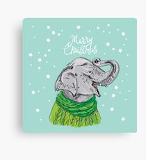 Merry Christmas New Year's card design Elephant head with a raised trunk in a knitted sweater and a green scarf. Sketch drawing. Black contour on a blue background Canvas Print