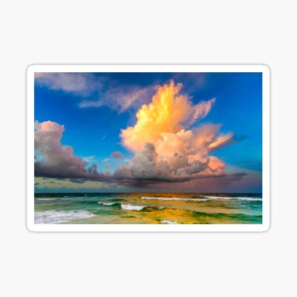 Golden cloud above the ocean. Sticker