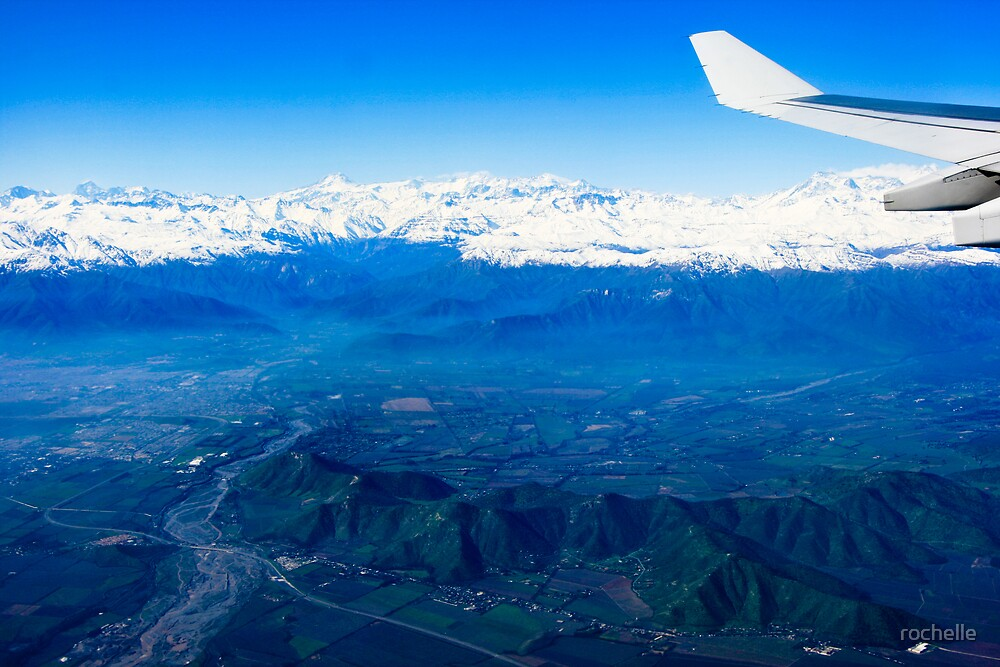Flying high over the snow tipped andean peaks of Santiago by rochelle