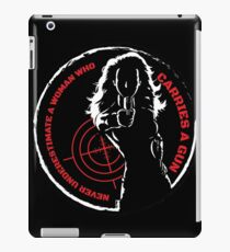 Never Underestimate A Woman Who Carries A Gun iPad Case/Skin