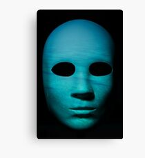 Textured mask with underwater painted surface, neutral expression on dark background. Canvas Print