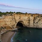 Blue Hour with a Hint of Pink at Vale Covo Sea Cave in Algarve Portugal by Georgia Mizuleva