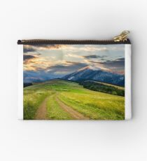 Winter in mountains meets spring in valley Studio Pouch