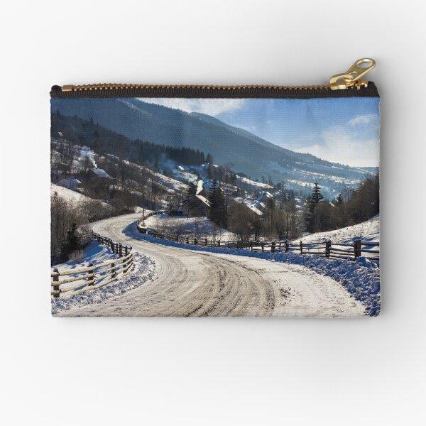 rural mountain road in snow Zipper Pouch