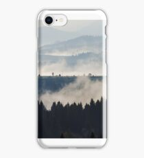 cold fog on hot sunrise in mountains iPhone Case/Skin