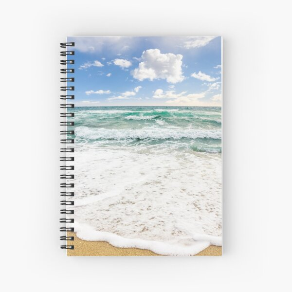 sea ​​waves breaking on the sandy beach Spiral Notebook