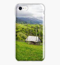 storage of firewood on hillside meadow in mountain iPhone Case/Skin