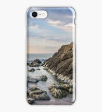 rocks and seaweed on rocky coast of the sea iPhone Case/Skin