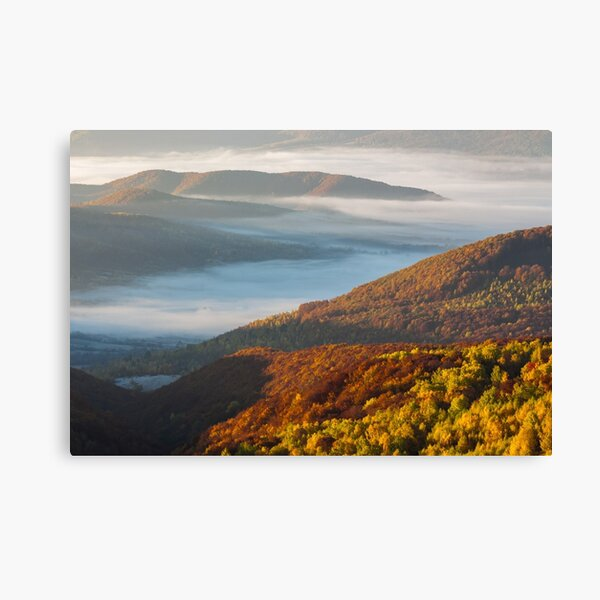 cold fog on hot sunrise in mountains Canvas Print