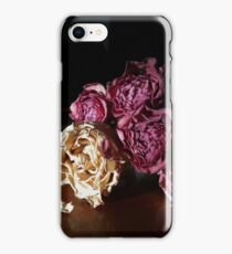 Dried roses on tabletop iPhone Case/Skin