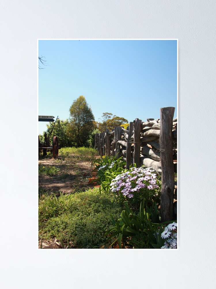 Alternate view of Flowers by the fence Poster