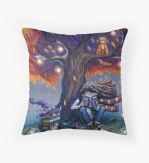 Young witch reading magic book Throw Pillow
