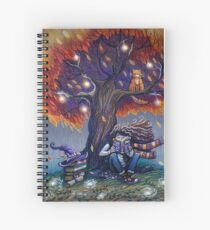 Young witch reading magic book Spiral Notebook