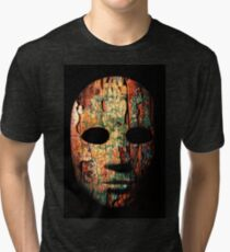 Textured mask with cracked rough wood  painted surface, neutral expression on dark background. Tri-blend T-Shirt